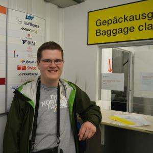This photo of me was taken by Laura Woolfolk at the old Berlin Tegel International Airport Baggage Claim. With armed guards outside and austere surroundings, we thought we were in some sort of Turkish prison! It made for a funny story to tell others when discussing late and lost baggage.