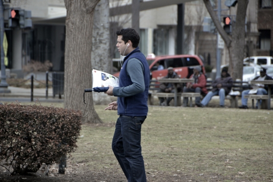 People of Dupont Circle:  I'm sure he's just talking on the phone, but it looks like he's learning a new language.